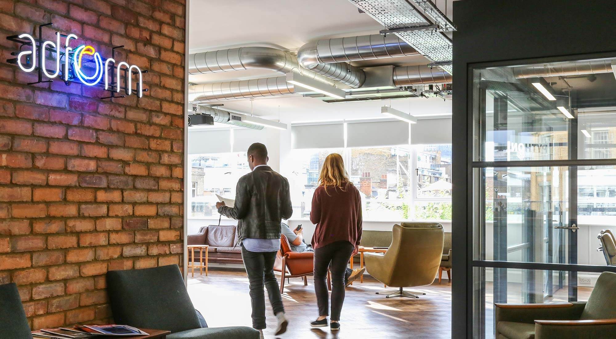london office brick slip feature wall and midcentury design