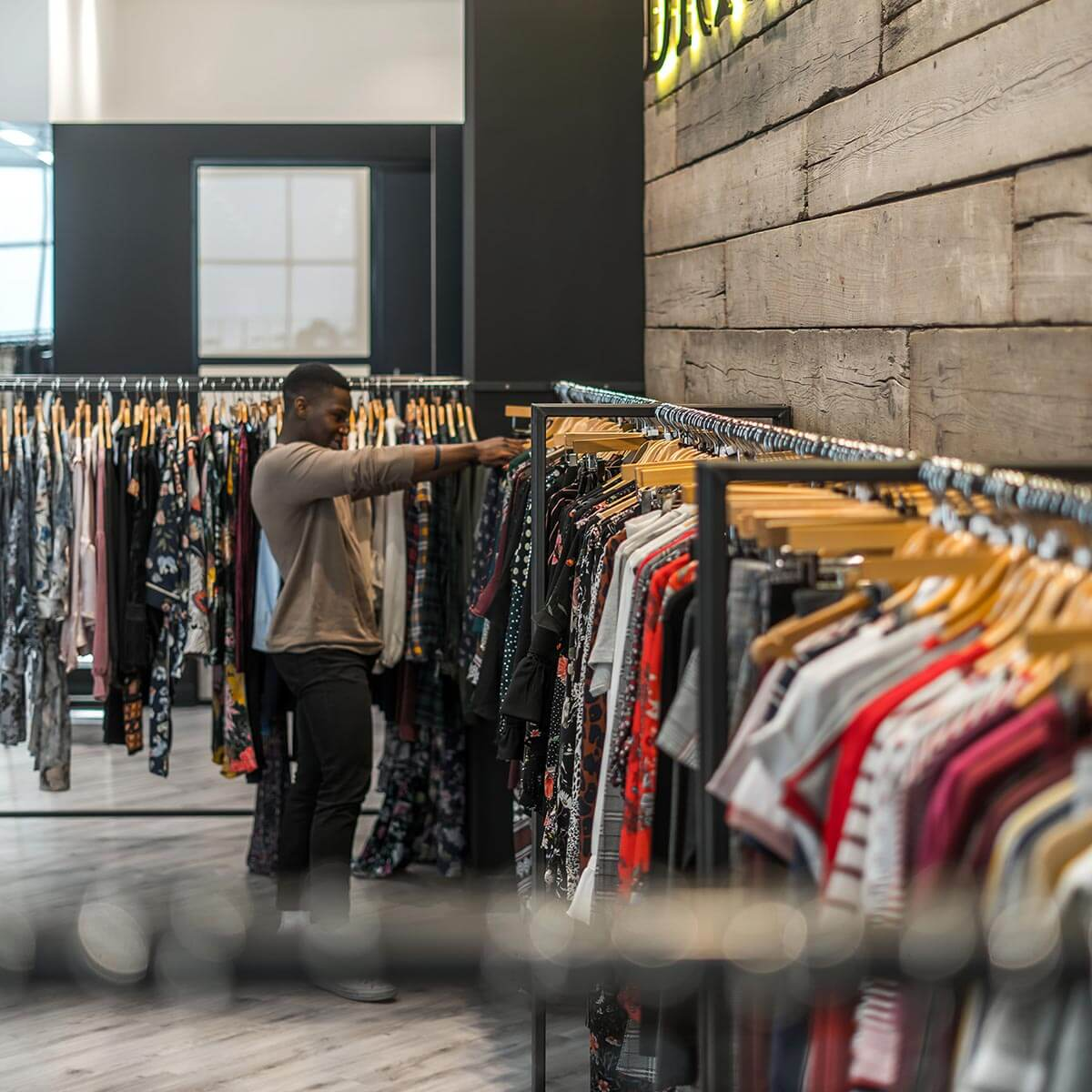 office showroom design with bespoke industrial clothing rails