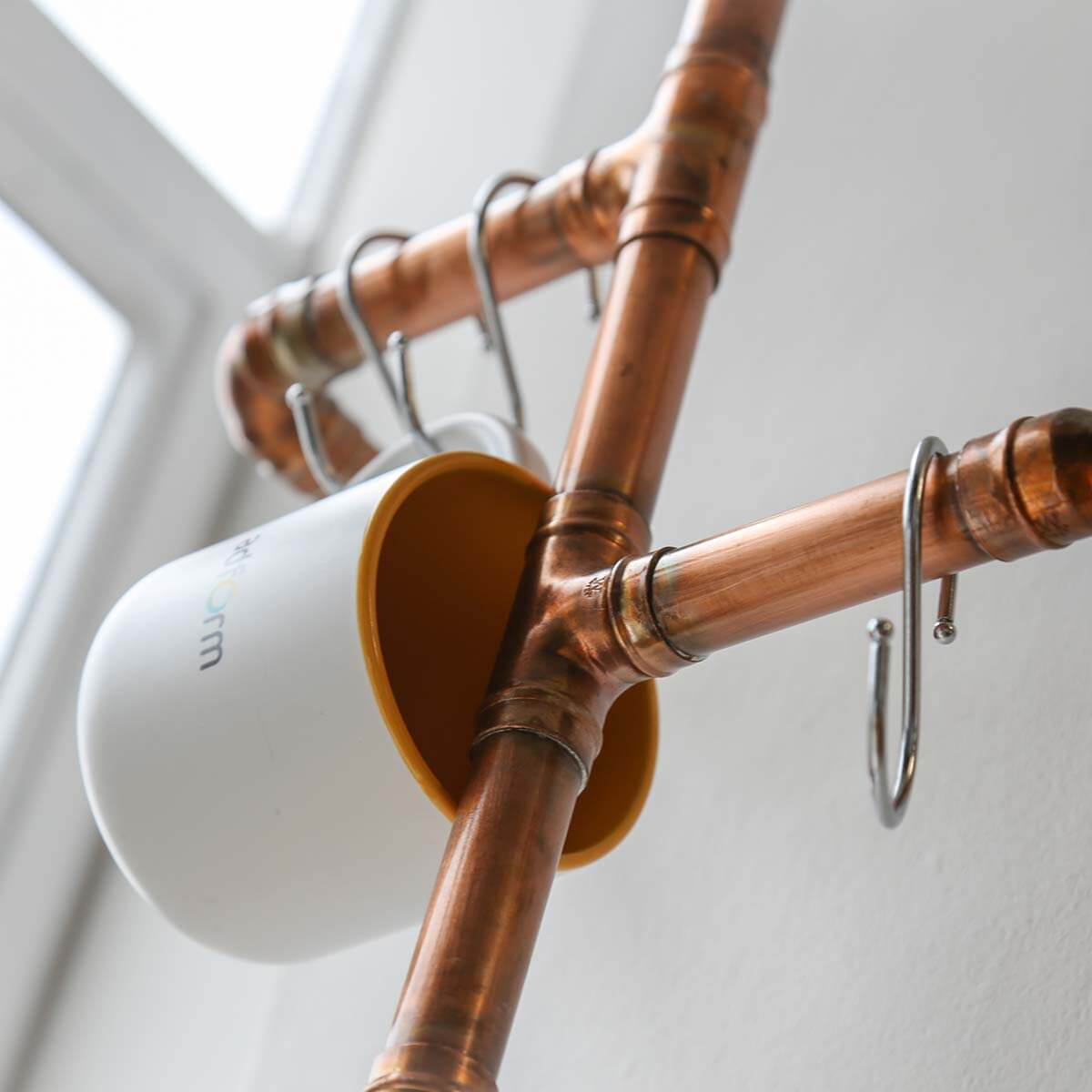 office design company with copper bespoke cup hanging tree