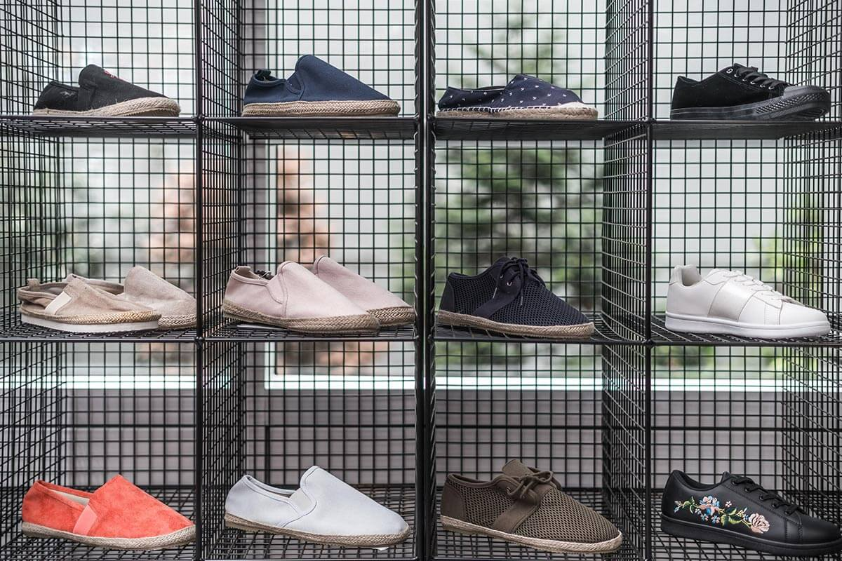 london showroom office detail shoe display industrial mesh