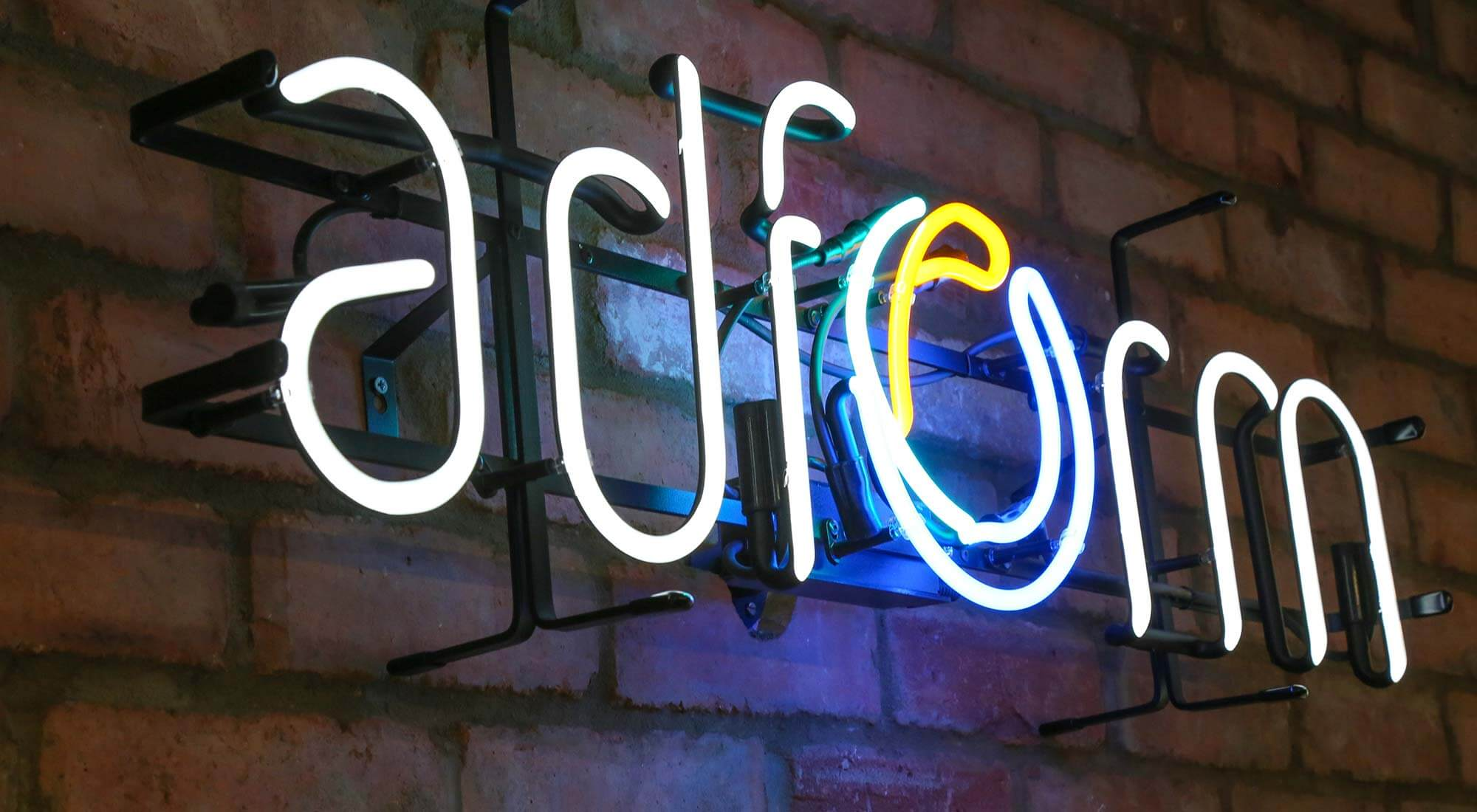 office design company transforms adform bespoke neon sign