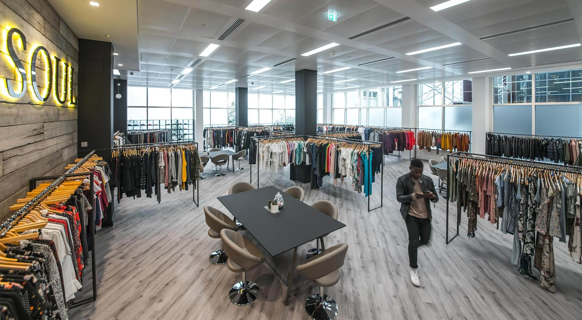 london showroom office design and build with hanging rails and lvt moduleo flooring