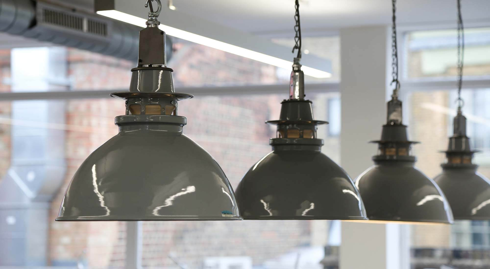 london office design with reclaimed industrial pendants