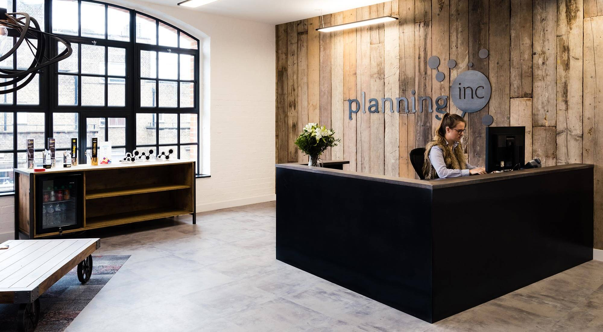 london office reception with industrial feel