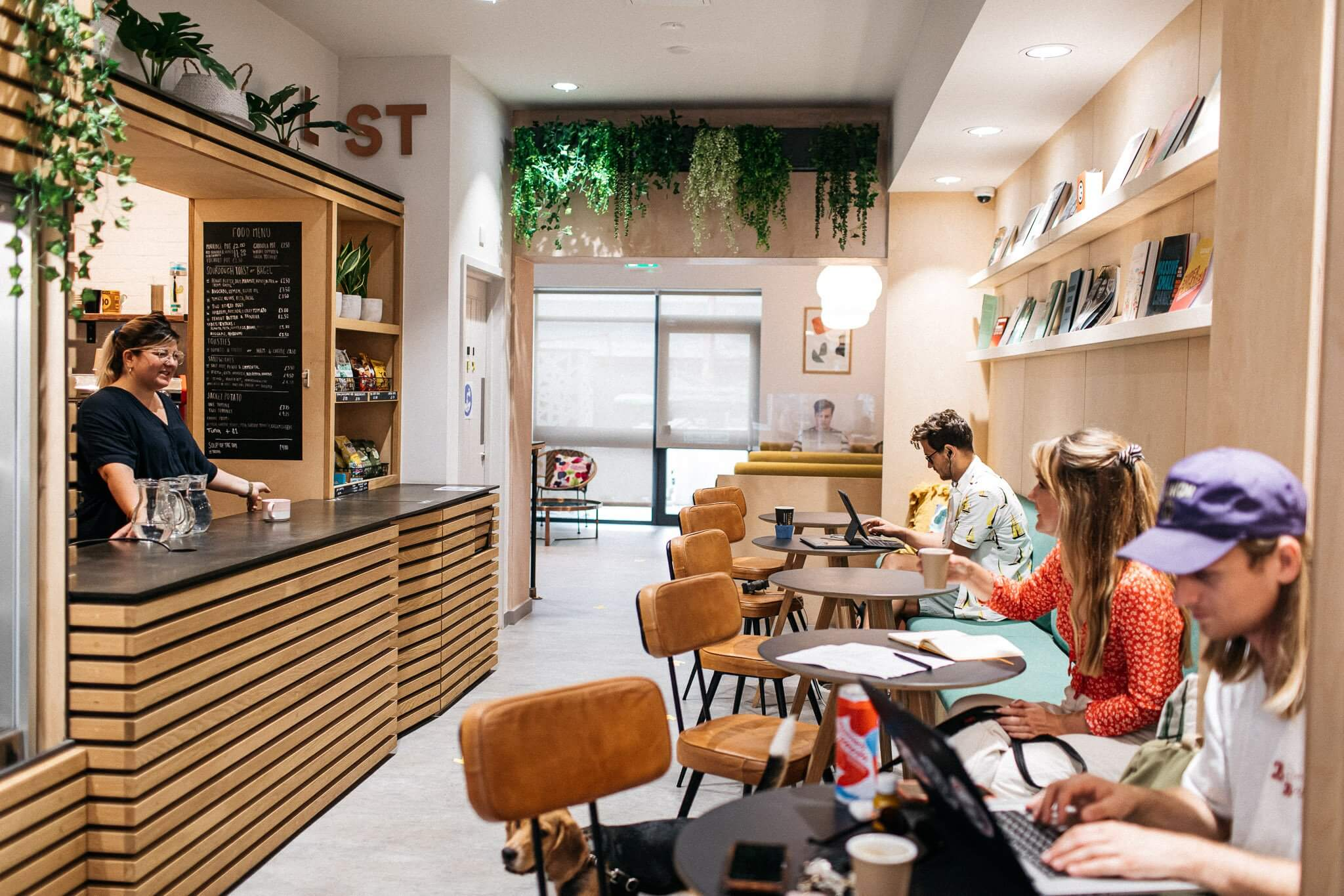 Co-working Space With Cafe And Multiple Seating Areas
